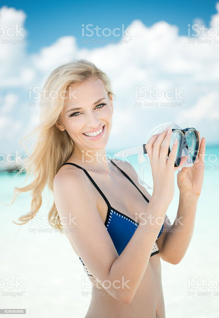 Woman with Scuba Mask on Vacation stock photo