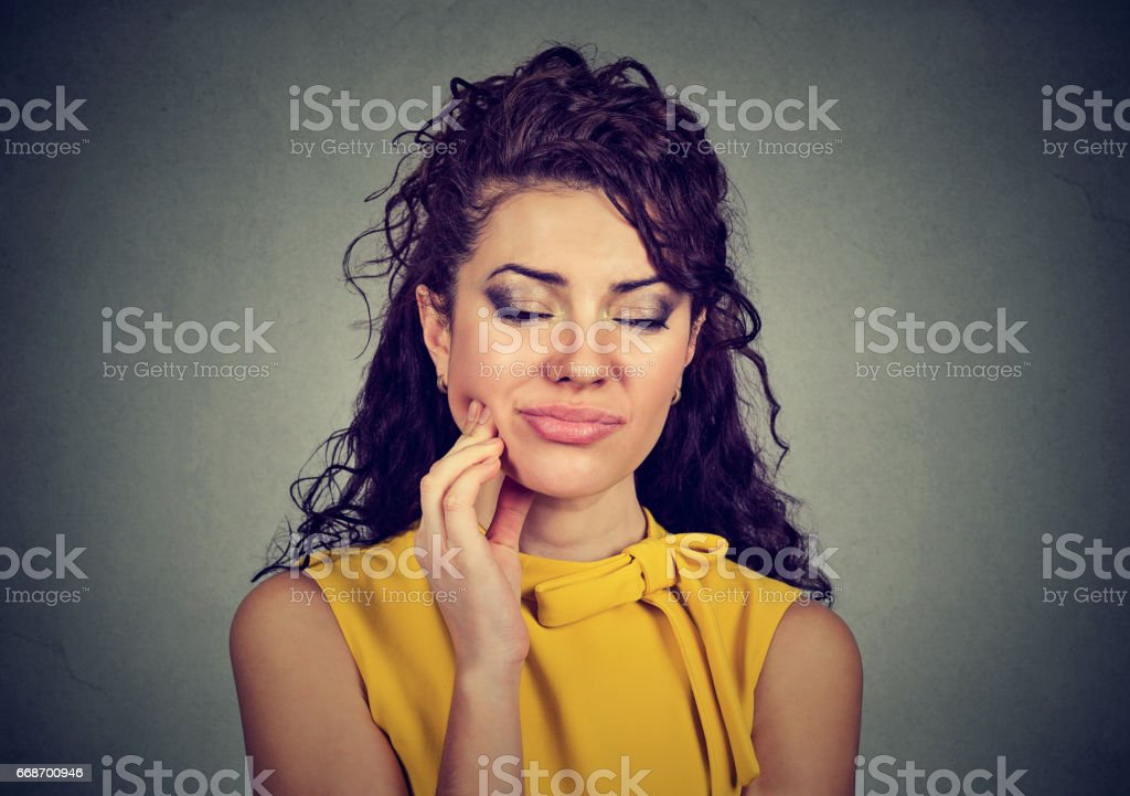 Woman with sensitive tooth ache crown problem about to cry from pain stock photo