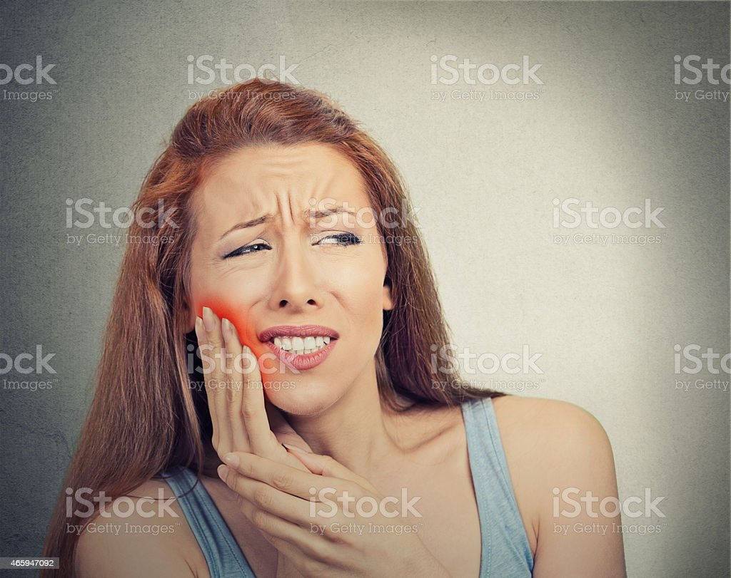 woman with sensitive tooth ache crown problem stock photo