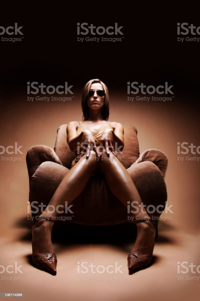 Woman with Serious Attitude in Chair royalty-free stock photo