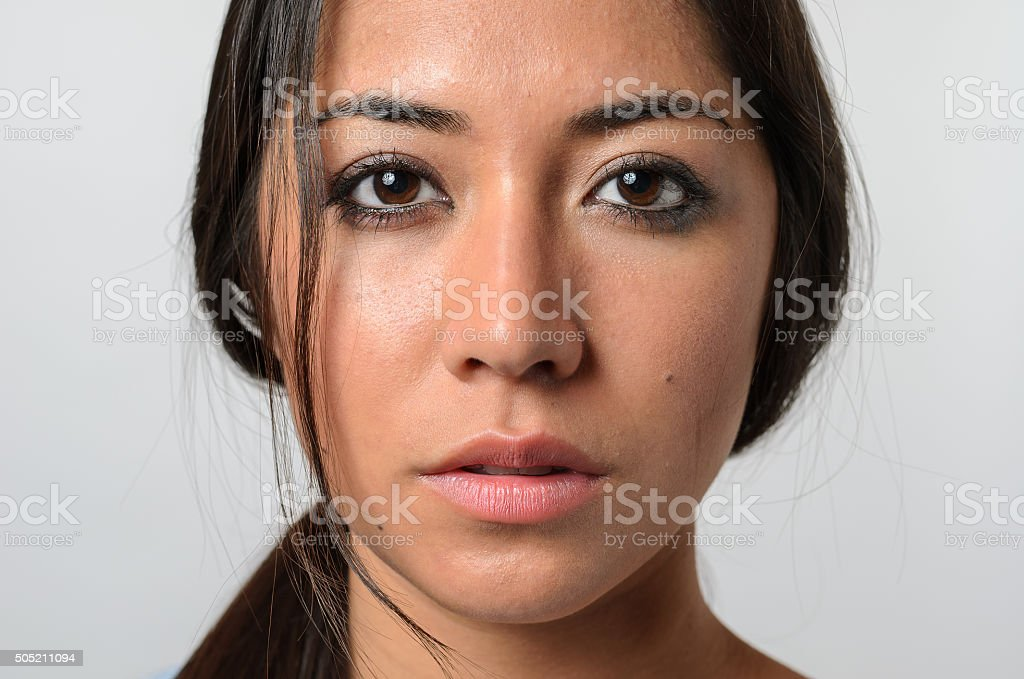 Woman with serious blank stare stock photo