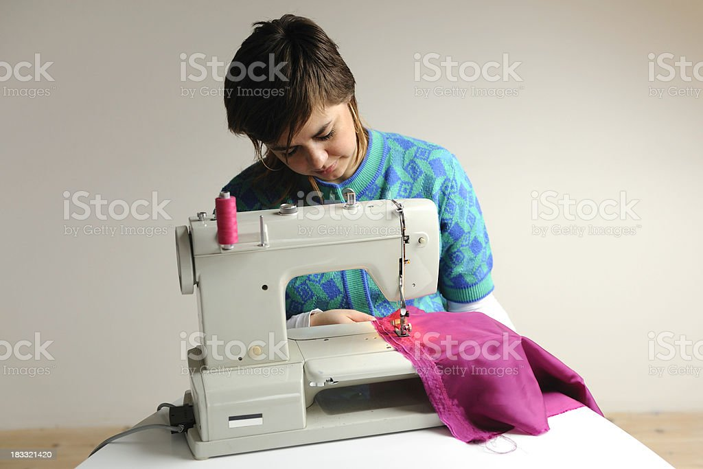 Woman with sewing machine royalty-free stock photo