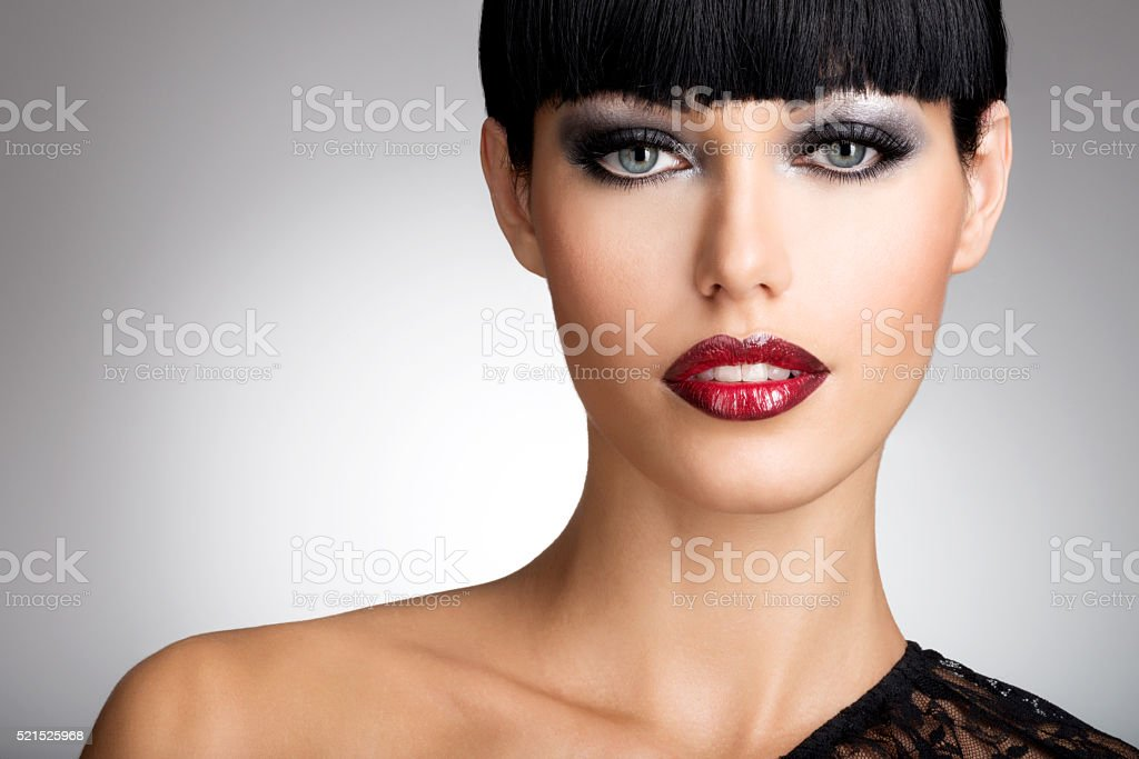 woman with  sexy red lips and fashion color eye makeup stock photo