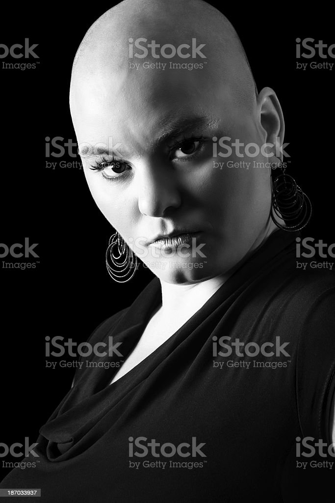 Woman with shaved head and dramatic look in B&W. royalty-free stock photo
