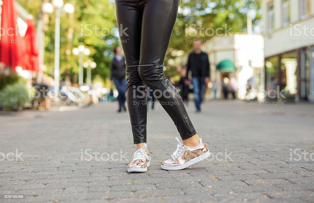 Woman with shinny sneakers stock photo