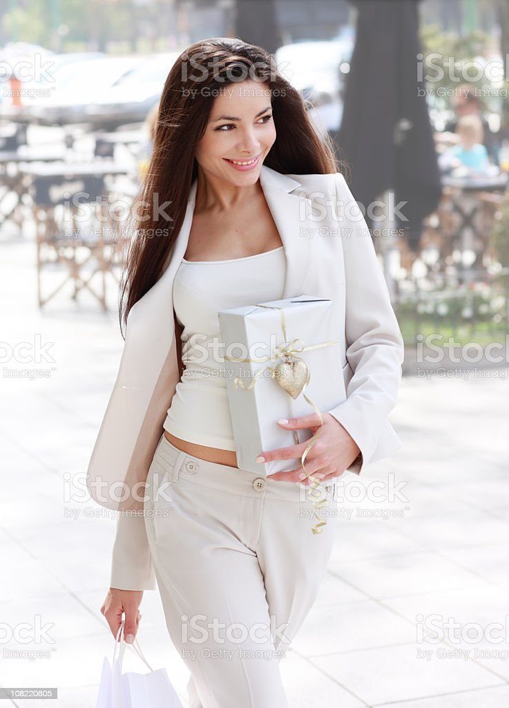 Woman with shopping bag and a gift stock photo