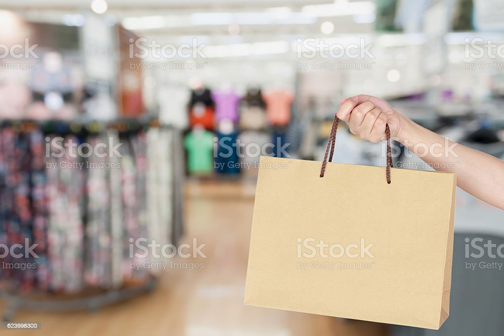 Woman with shopping bag in store stock photo