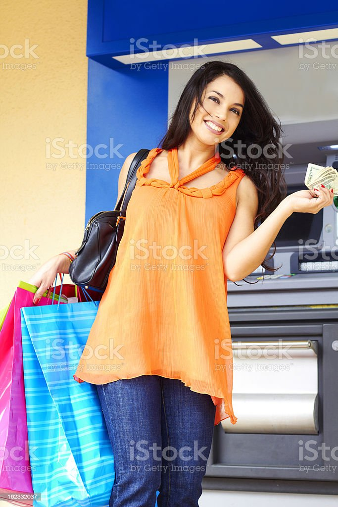 Woman With Shopping Bags And Cash royalty-free stock photo