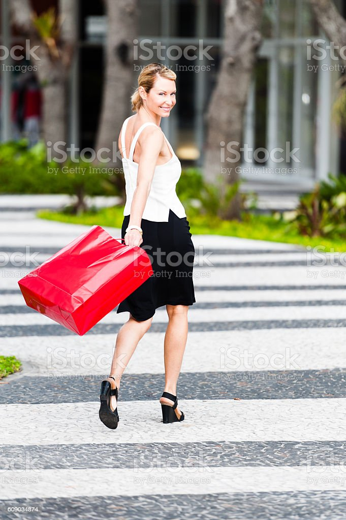 Woman with shopping bags at Lincoln Road outdoor mall stock photo