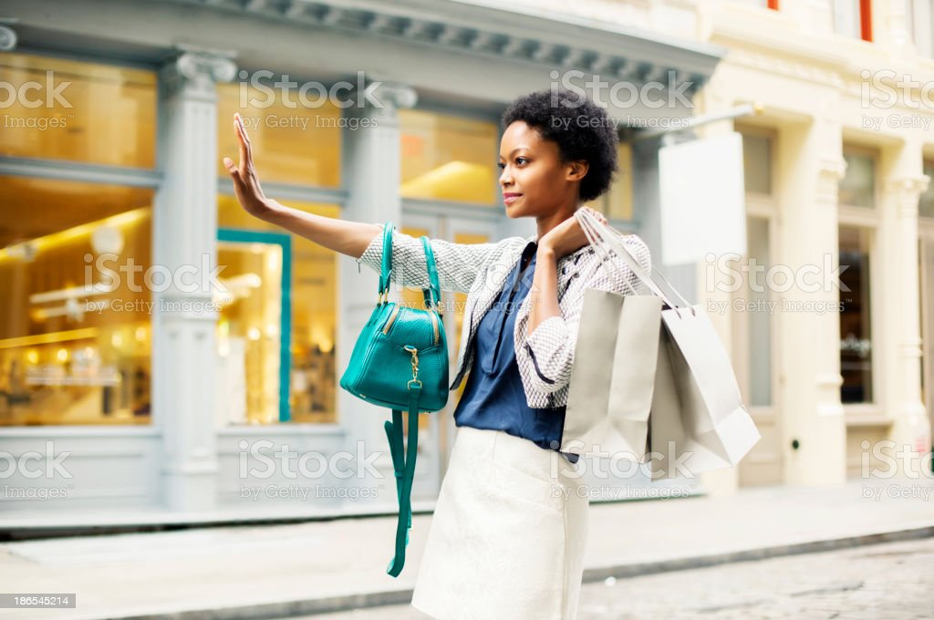 Woman with shopping bags in New York stock photo