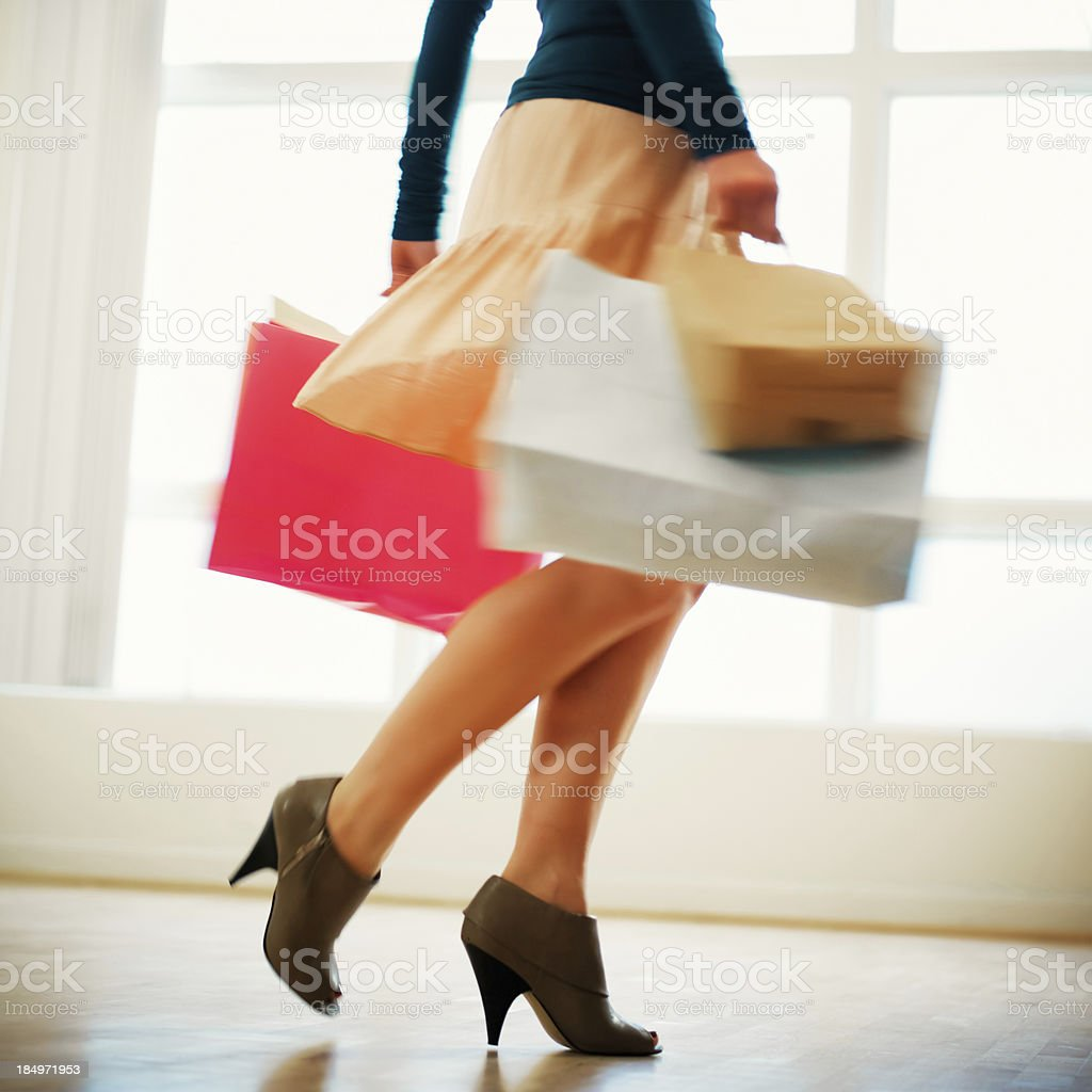 Woman With Shopping Bags Wearing High Heels stock photo