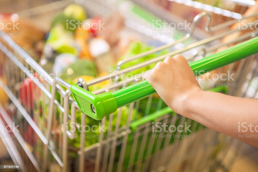 Woman with shopping cart. stock photo