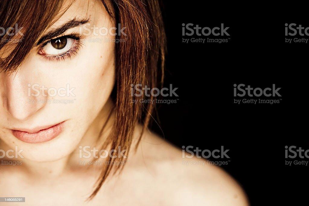 Woman with short hair looking at the camera royalty-free stock photo