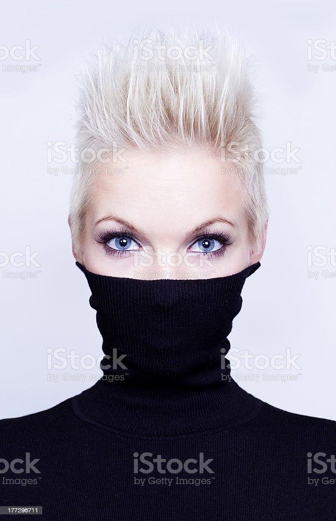 woman with short hair wearing black turtleneck stock photo