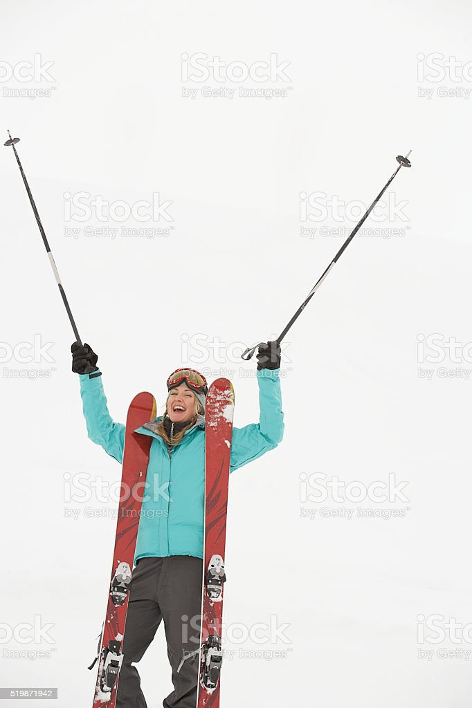 Woman with skis stock photo
