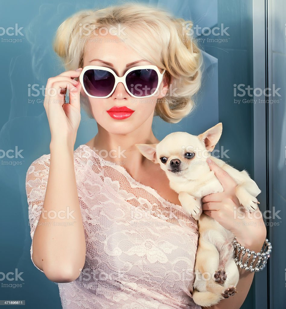 woman with small dog stock photo