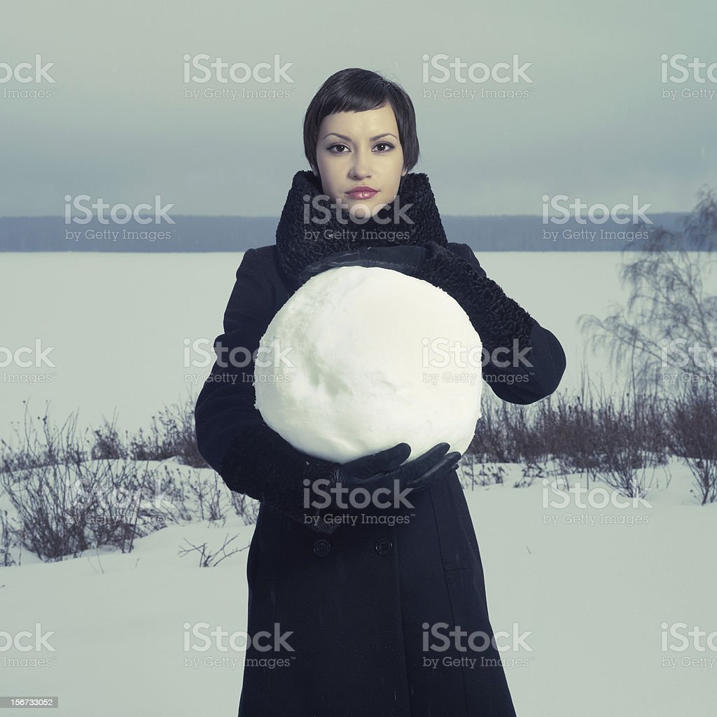 Woman with snow ball royalty-free stock photo