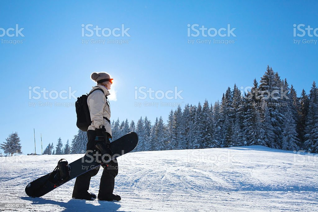 woman with snowboard stock photo