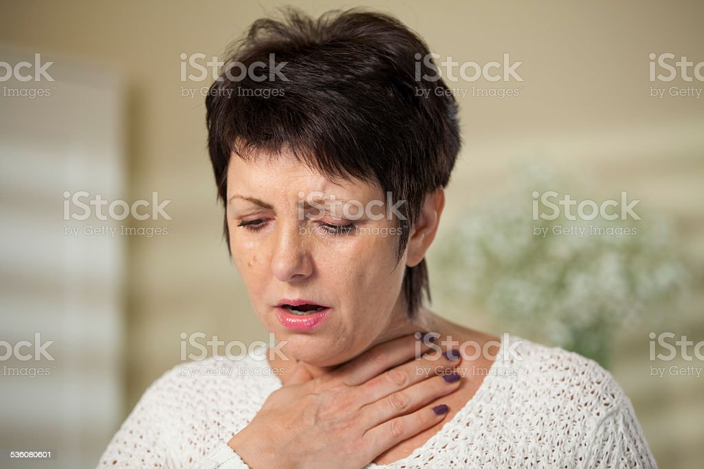 Woman with sore throat stock photo