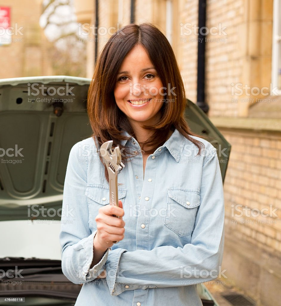 woman with spanner royalty-free stock photo
