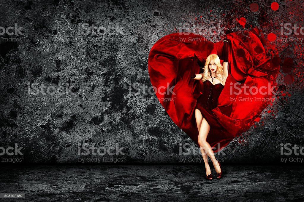 Woman with Splashing Heart on Dark Background stock photo
