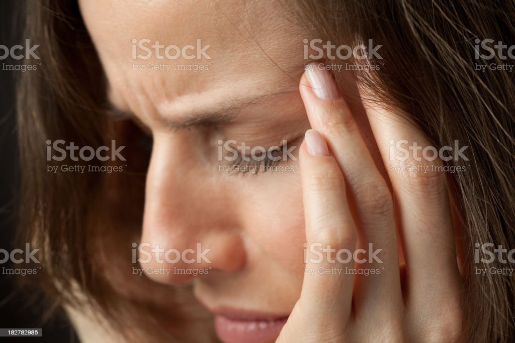 Woman with splitting headache stock photo