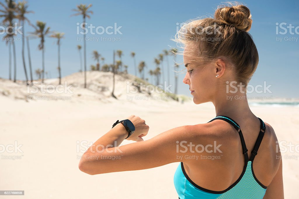 Woman with Sport Watch at the Beach, Dessert Dune stock photo