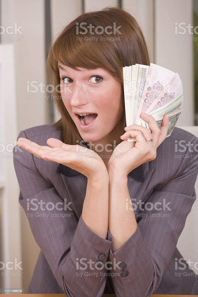woman with stack of money stock photo