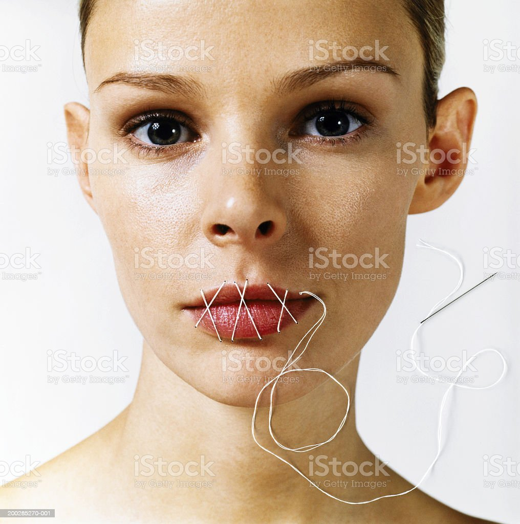 Woman with stitches over mouth, portrait stock photo