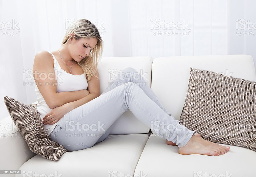 Woman with stomach ache stock photo