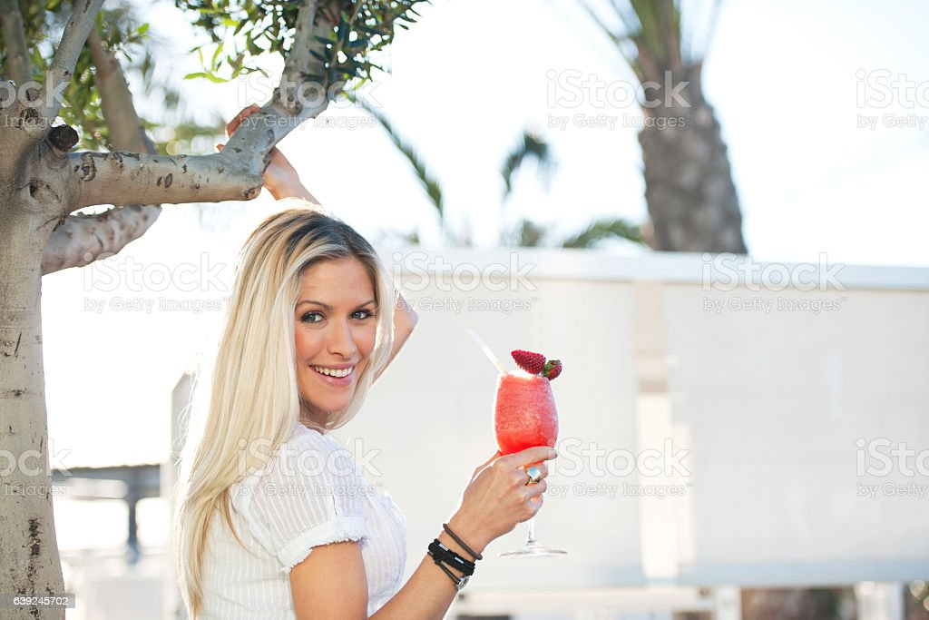 Woman with strawberry smoothie stock photo