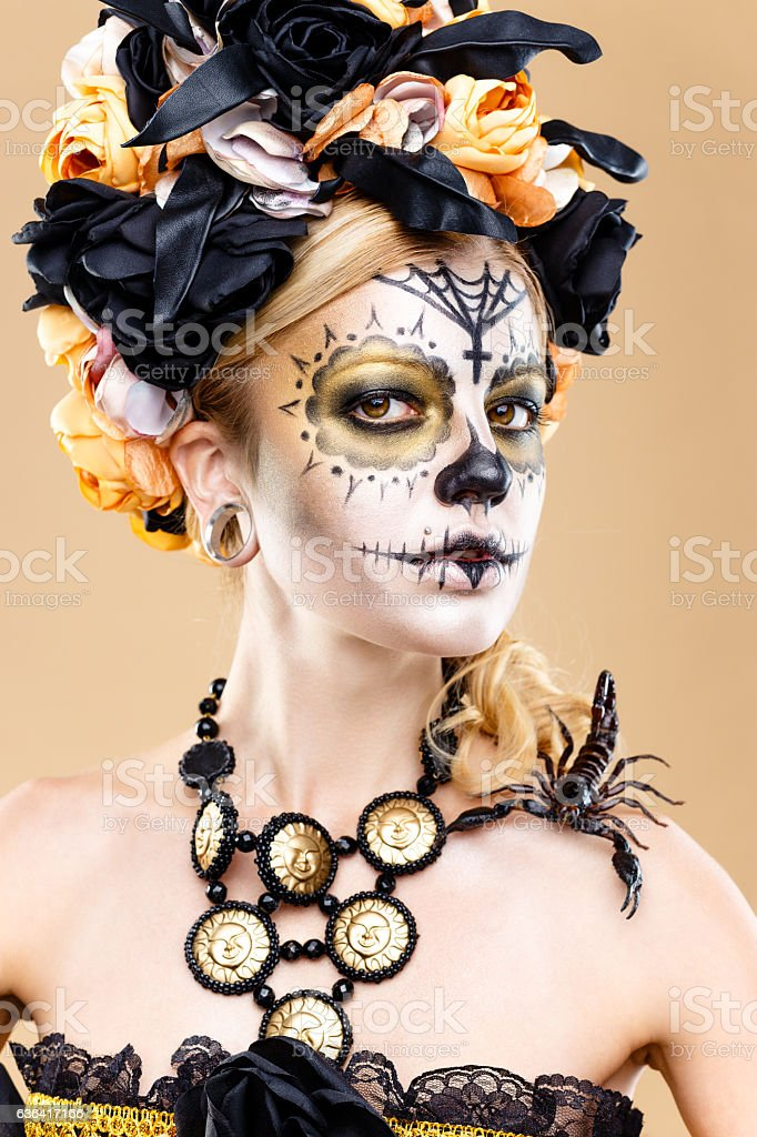 woman with sugar skull makeup stock photo