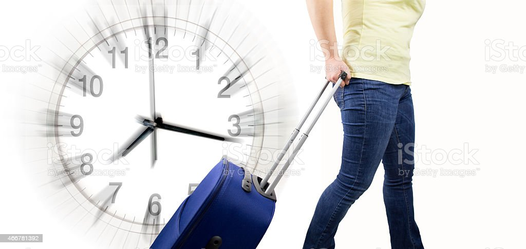 woman with suitcase arrival at time stock photo