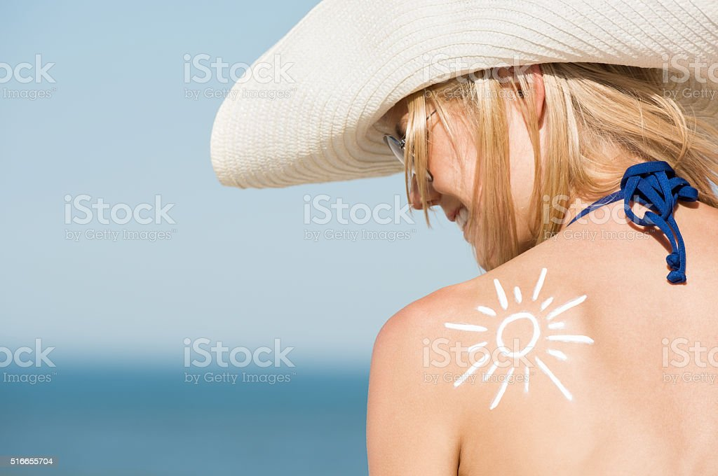 Woman with sunscreen stock photo