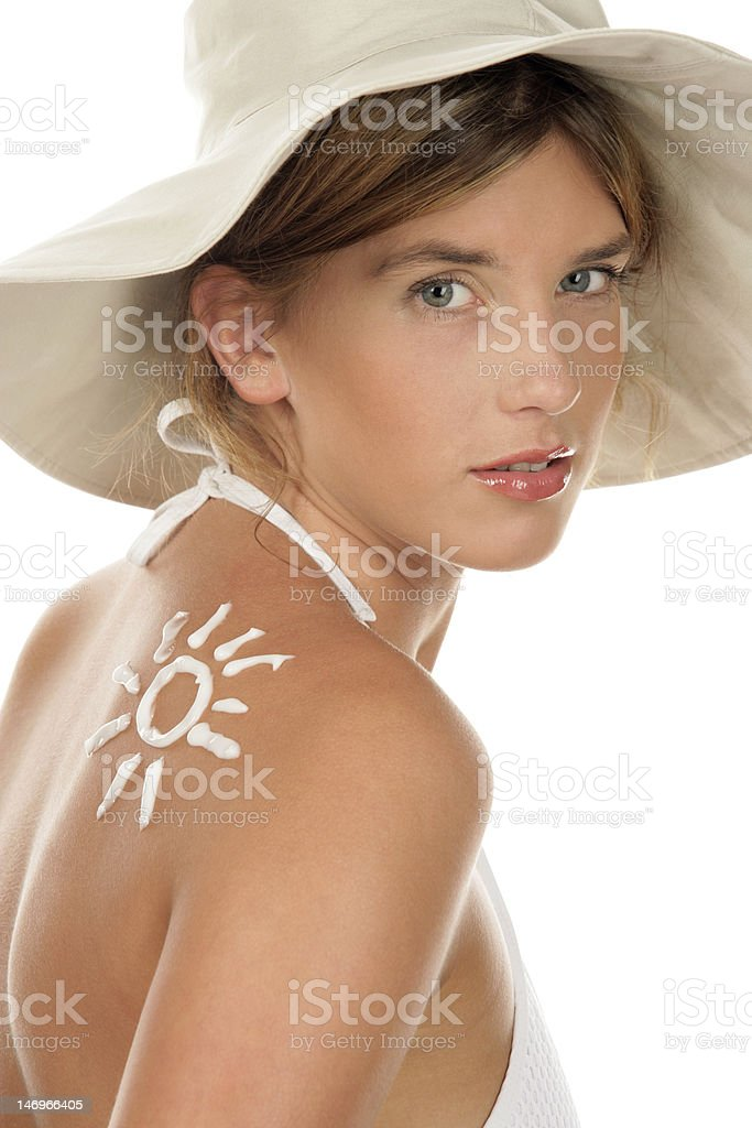 Woman with sun-shaped sun cream royalty-free stock photo