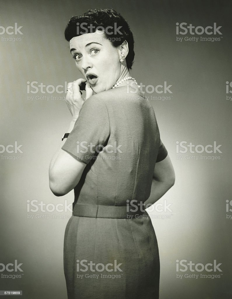 Woman with surprised look in studio, (B&W),  portrait royalty-free stock photo