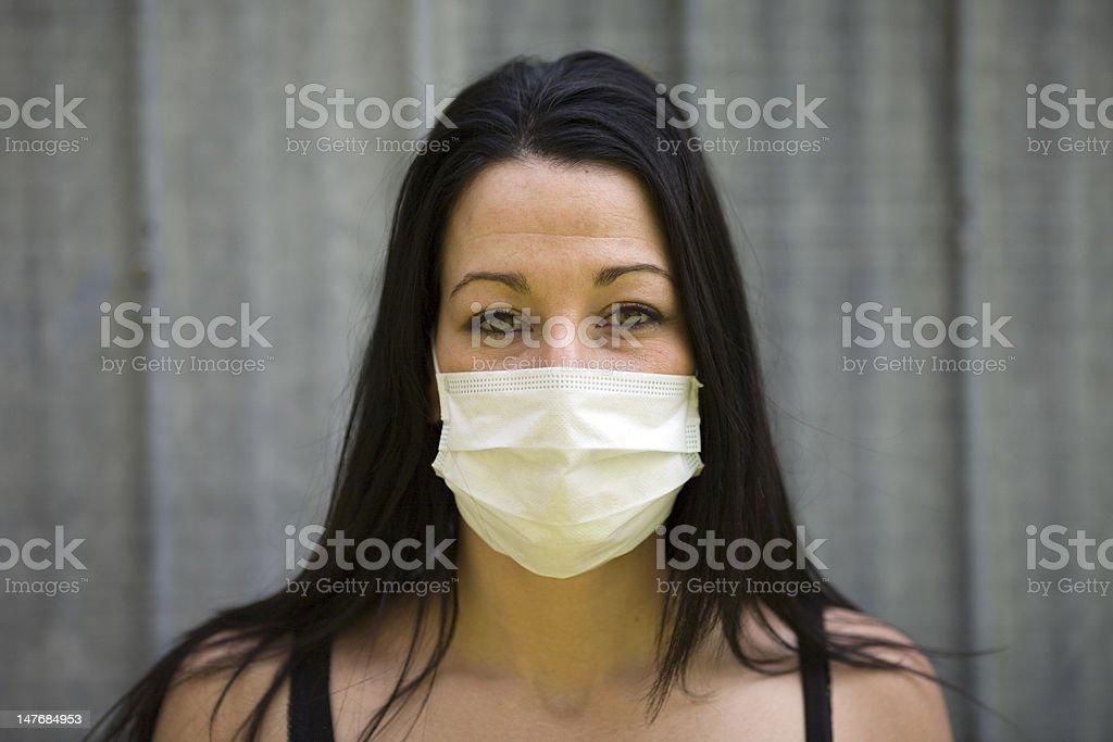 woman with swine flu mask stock photo