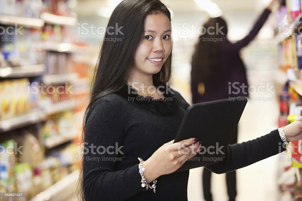 Woman with Tablet Computer Shopping List royalty-free stock photo