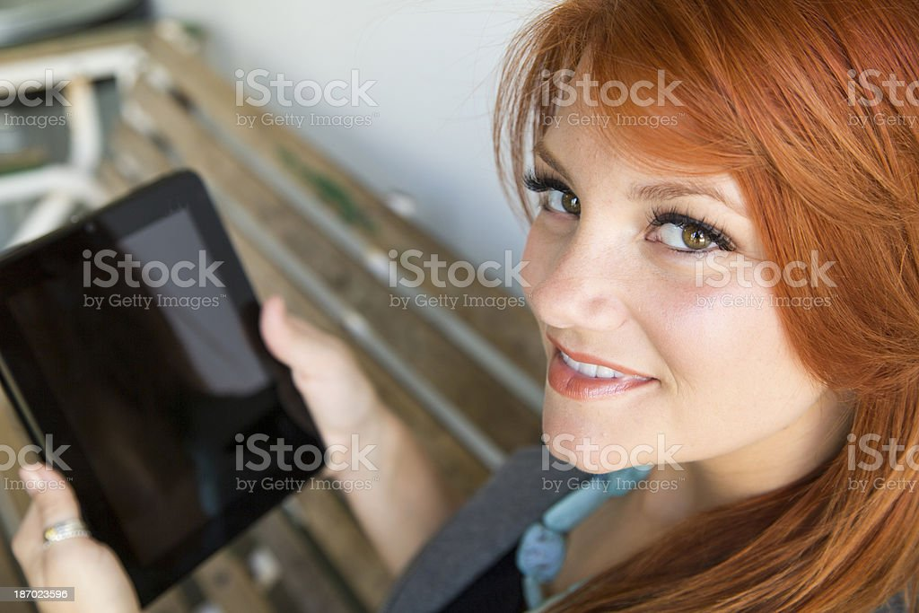 Woman with Ipad Tablet on Bench royalty-free stock photo