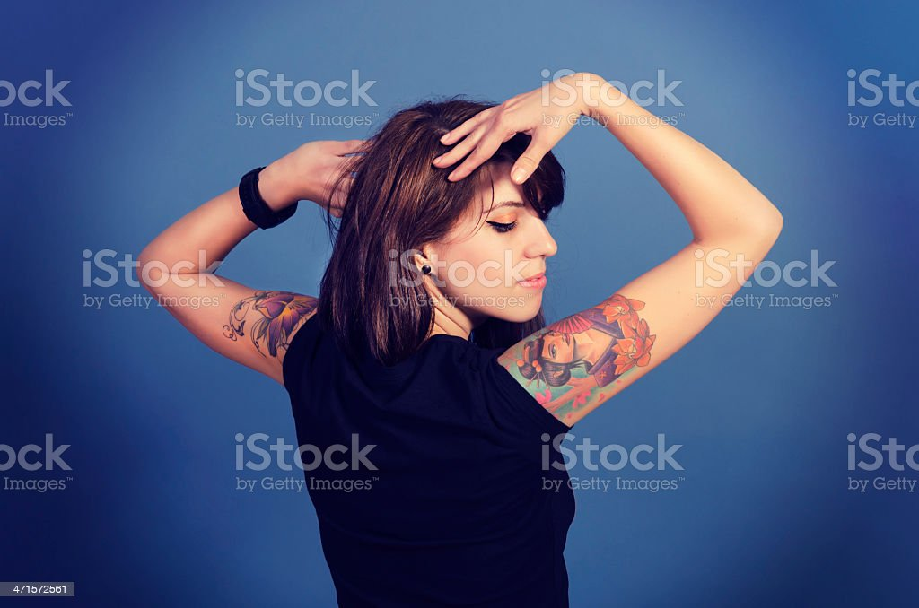 Woman with tatoo royalty-free stock photo