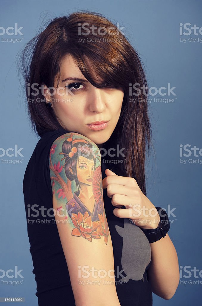 Woman with tattooed arm royalty-free stock photo