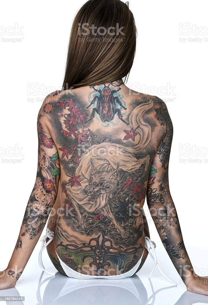 Woman with tattooed back royalty-free stock photo