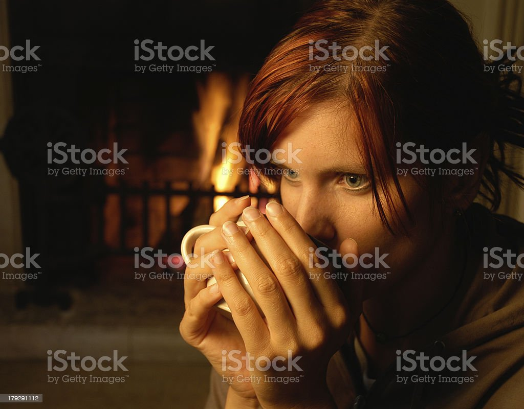woman with tea (chimney behind) royalty-free stock photo