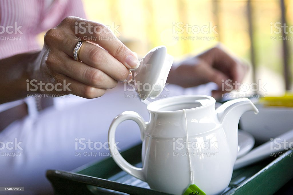 Woman with teapot royalty-free stock photo