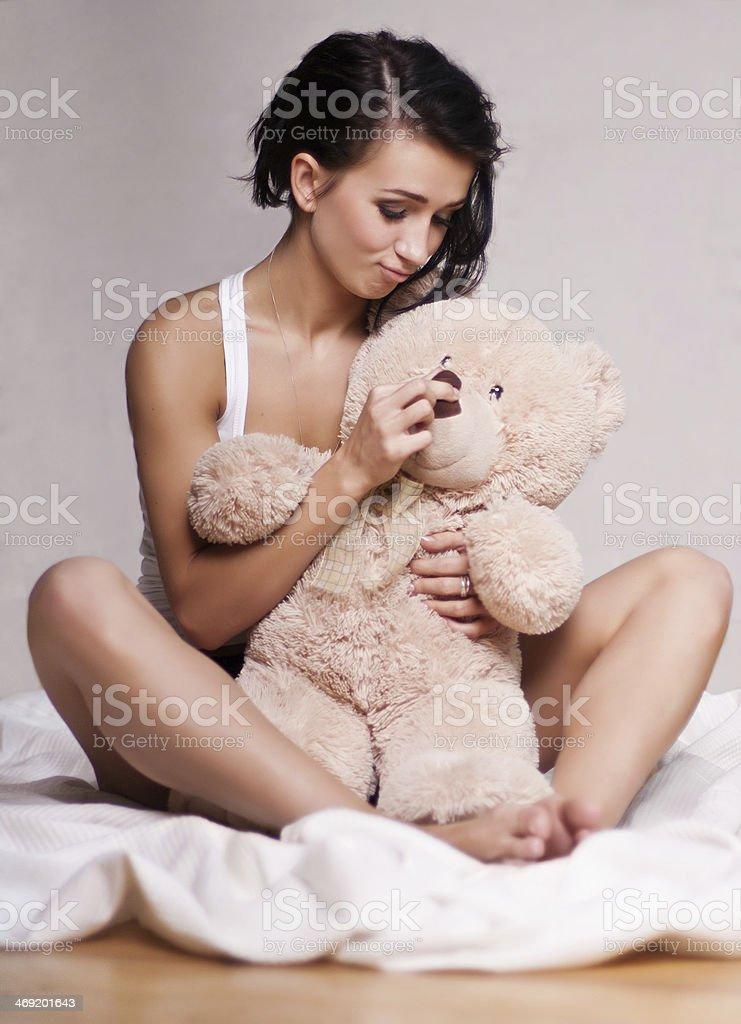 Woman with Teddy bear stock photo