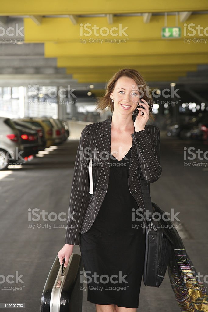 woman with telephone and bag stock photo
