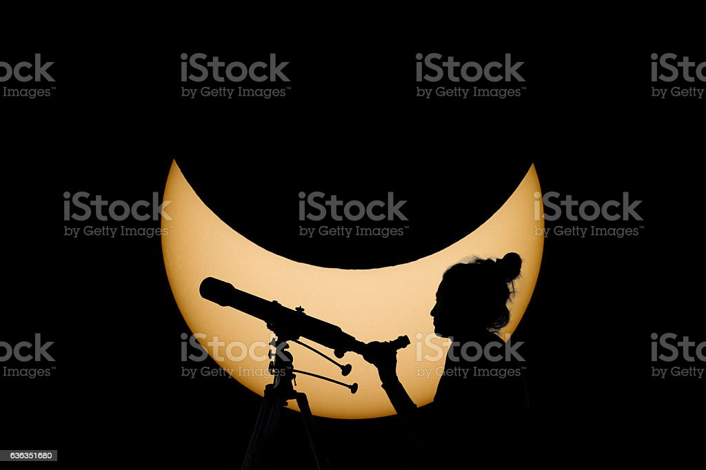 Woman with telescope Safe Solar Eclipse observation stock photo