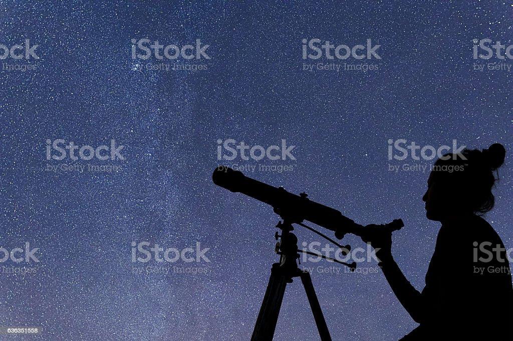 Woman with telescope watching the stars. Stargazing woman night sky stock photo