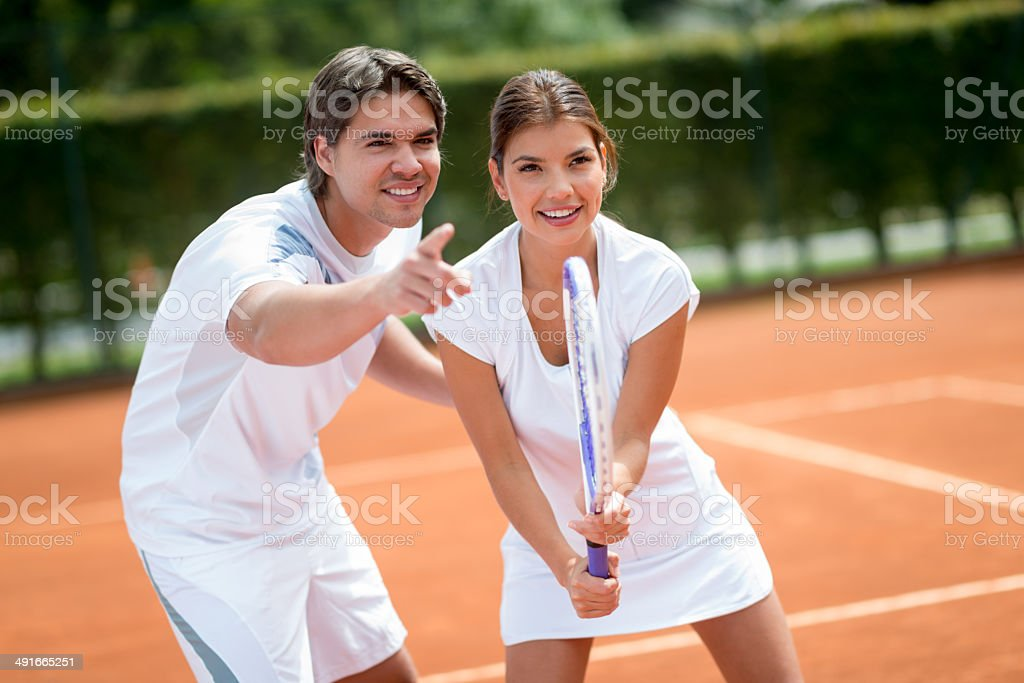 Woman with tennis trainer stock photo