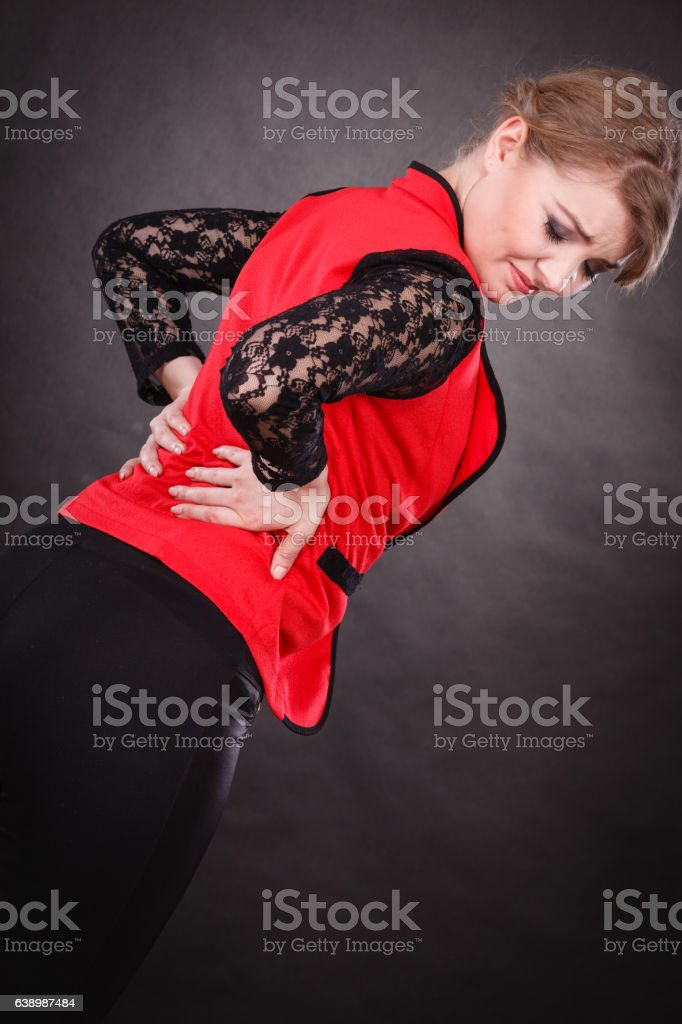 Woman with terrible back pain. stock photo